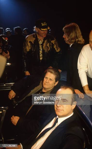 Brian Wilson of the Beach Boys and Francis Rossi of Status Quo, with Mike Love of the Beach Boys and Rick Parfitt of Status Quo behind them, at...