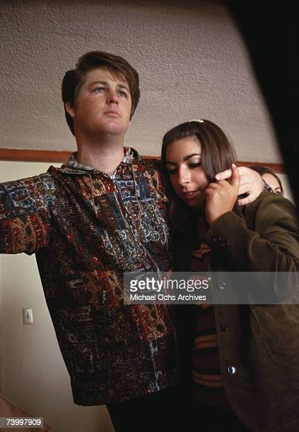 Brian Wilson of the rock and roll band The Beach Boys poses for a portrait with his wife Marilyn in circa 1965 in Los Angeles California