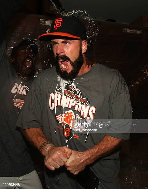 Brian Wilson of the San Francisco Giants celebrates in the locker room after defeating the San Diego Padres to win the National League West during a...