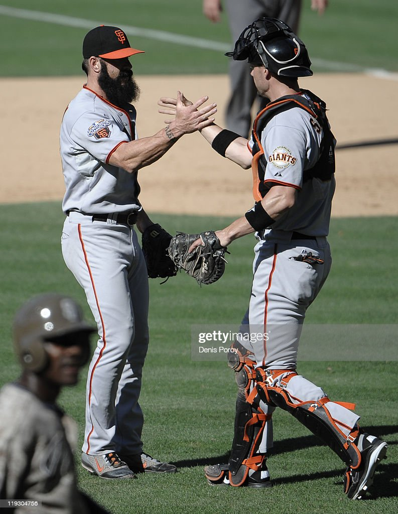 Brian Wilson #38 of the San Francisco Giants, left, is congratulated by Chris Stewart #37 after the final out during the 11th inning of a baseball game against the San Diego Padres at Petco Park on July 17, 2011 in San Diego, California.