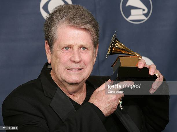 """Brian Wilson poses backstage with his award for """"Best Rock Instrumental Performance"""" for """"Mrs. O?Leary?s Cow"""" during the 47th Annual Grammy Awards at..."""