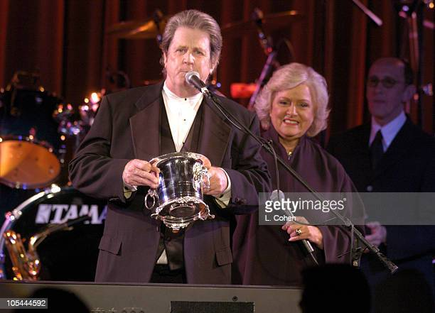 Brian Wilson recieves the BMI ICON award from Frances W Preston president/CEO of BMI