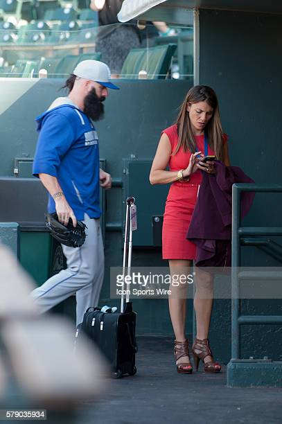 Brian Wilson walks past Alanna Rizzo in the visiting dugout before a regular season Major League Baseball game between the Los Angeles Dodgers and...