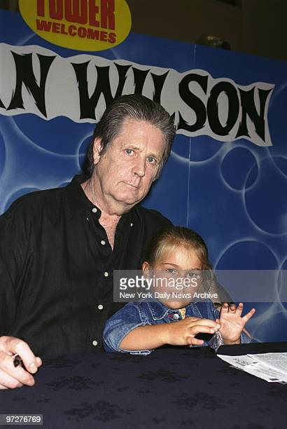 Brian Wilson's daughter Daria helps dad by handing out pins to the fans lined up to get their copies of the former Beach Boy's CD Live at the Roxy...