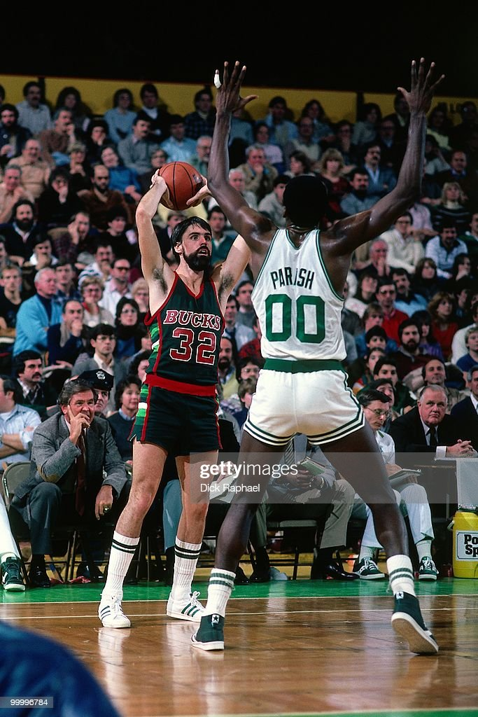 Brian Winters #32 of the Milwaukee Bucks looks to make a plaly against Robert Parish #00 of the Boston Celtics during a game played in 1983 at the Boston Garden in Boston, Massachusetts.