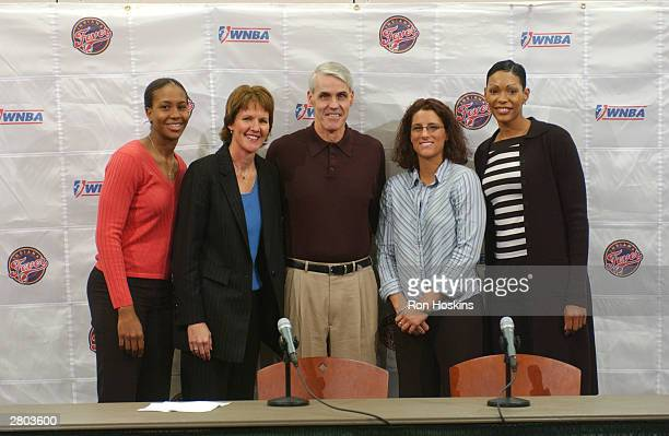 Brian Winters stands with Fever player Tamika Catchings Fever General Manager Kelly Krauskopf player Stephanie White 92ndR and Olympia...