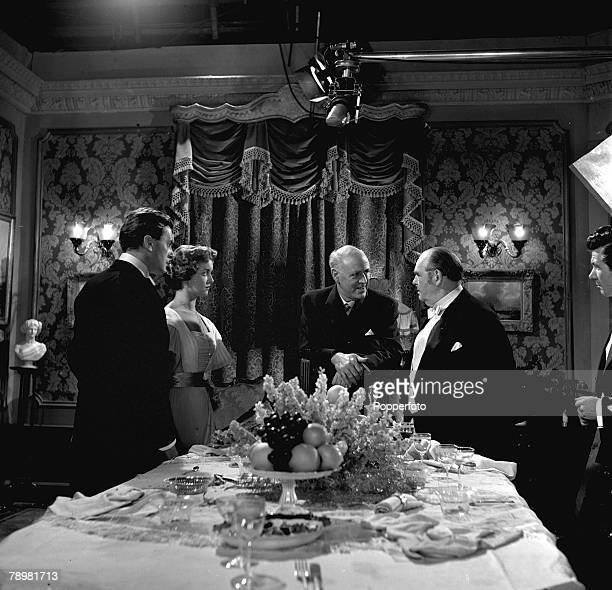 Brian Worth Eileen Moore Alistair Sim and Julian Mitchell in a scene from the film An Inspector calls