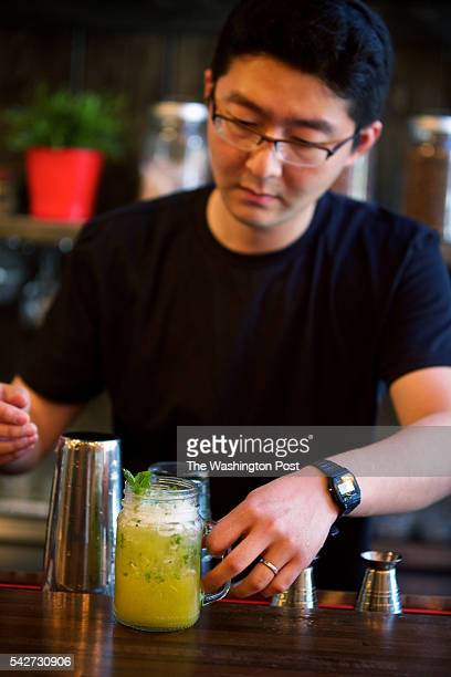 WASHINGTON DC Brian Yu a partner at Zannchi a new Korean restaurant in Georgetown makes a Korean Pino house craft drink photographed in Washington DC
