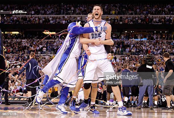 Brian Zoubek of the Duke Blue Devils reacts with teammates and the mascot after the Blue Devils defeat the Butler Bulldogs 61-59 in the 2010 NCAA...