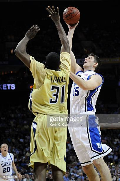 Brian Zoubek of the Duke Blue Devils shoots over Ganai Lawal of the Georgia Tech Yellow Jackets during day two of the 2008 Men's ACC Basketball...