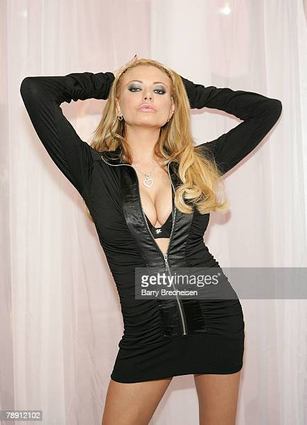 Briana Banks at the Vivid booth in the Sands Expo Center at the 2008 AVN Adult Entertainment Expo on January 11 2007 in Las VegasNevada