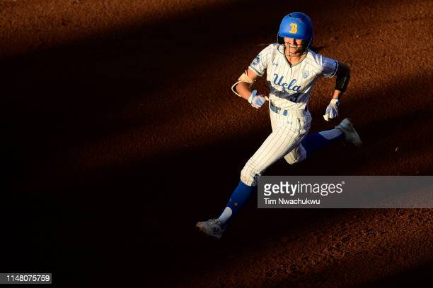 Briana Perez of the UCLA Bruins celebrates after hitting a home run against the Oklahoma Sooners during the Division I Women's Softball Championship...