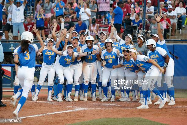 Briana Perez of UCLA Bruins hits a home run against the Oklahoma Sooners during the Division I Women's Softball Championship held at ASA Hall of Fame...