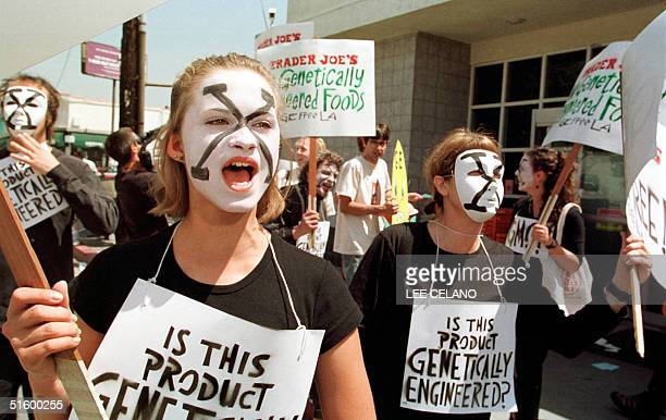 Briana Pienack and other protesters dressed in costume chant outside a supermarket during a demonstration against genetically engineered foods 17...