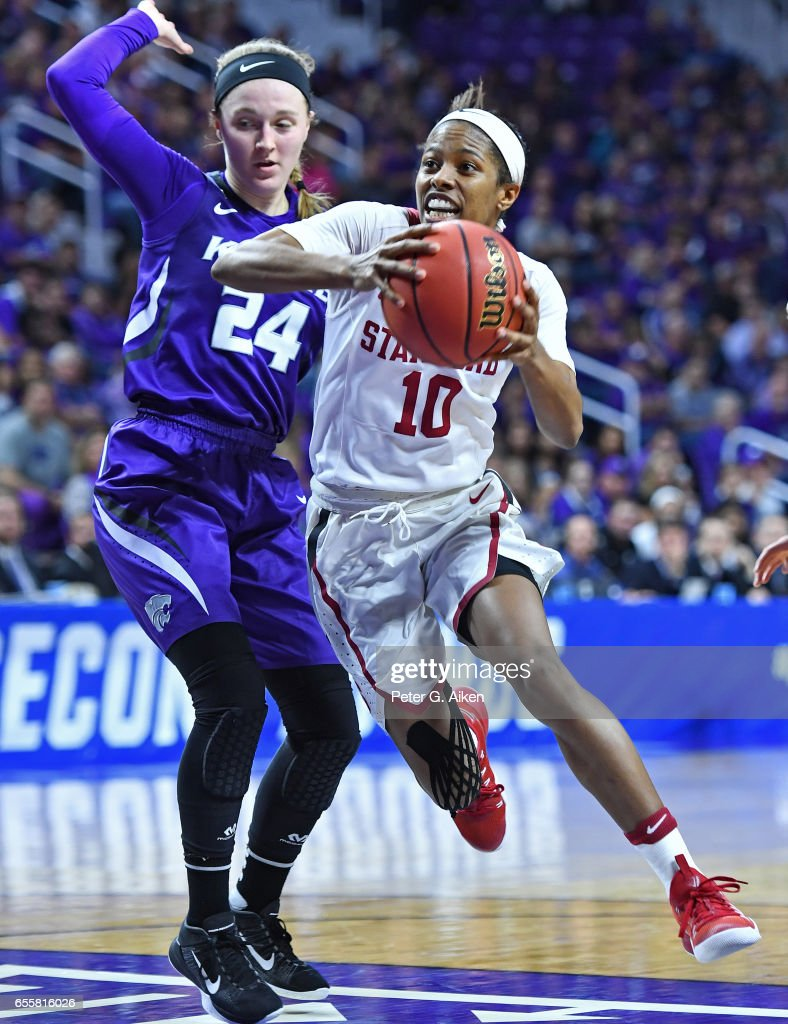 Briana Roberson #10 of the Stanford Cardinal drives around Kindred Wesemann #24 of the Kansas State Wildcats during the second round of the 2017 NCAA Women's Basketball Tournament at Bramlage Coliseum on March 20, 2017 in Manhattan, Kansas.