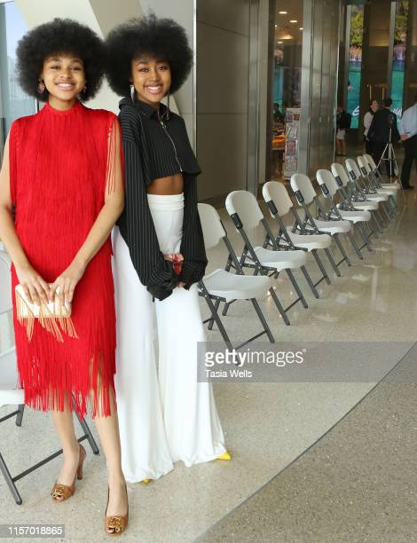 Briana Roy and Jenasha Roy attend the Sebastian Gunawan Couture Homecoming Runway Show at LAX Airport on June 18 2019 in Los Angeles California