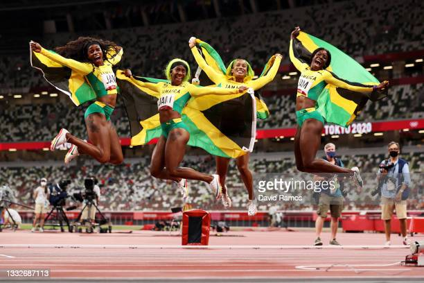 Briana Williams, Elaine Thompson-Herah, Shelly-Ann Fraser-Pryce and Shericka Jackson of Team Jamaica celebrate winning the gold medal in the Women's...
