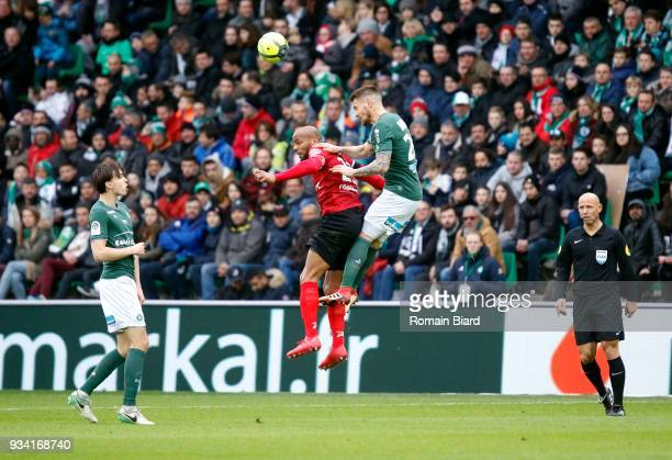 Briand Jimmy of Guingamp and Debuchy Mathieu of Saint Etienne and Selnaes Ole kristian of Saint Etienne and Delerue Amaury referee during the Ligue 1...