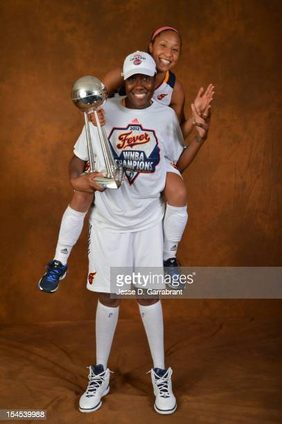 Briann January and Jessica Davenport of the Indiana Fever poses for portraits with the Championship Trophy after Game four of the 2012 WNBA Finals on...