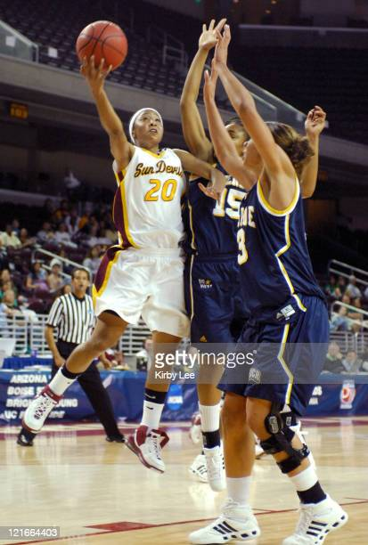 Briann January of Arizona State drives to the basket against Brittany Waddell and Shynell Foree of UC Riverside during the first half of NCAA Women's...