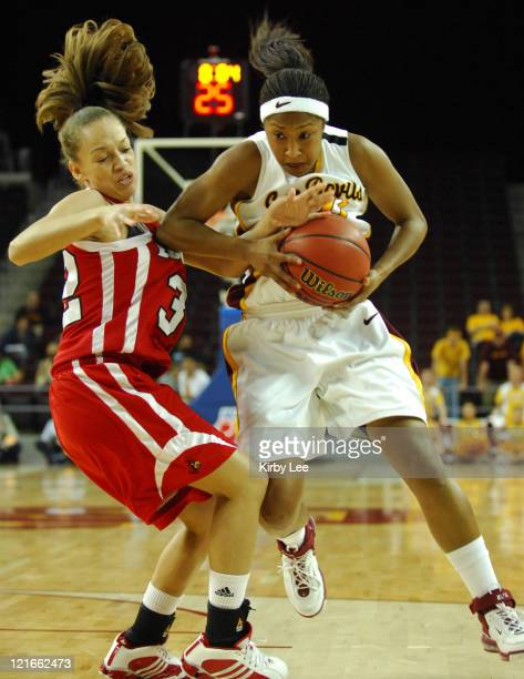 Briann January of Arizona State drives to the basket against Kala Faulkner of Louiville during the first half of NCAA Women's Basketball Championship...