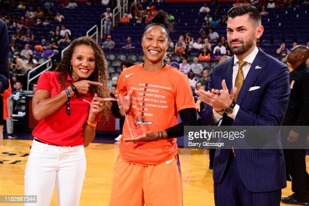 Briann January of Phoenix Mercury receives the NBA Cares Community Assist Award prior to a game against the Indiana Fever on June 28 2019 at the...