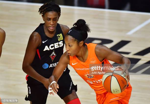 Briann January of the Connecticut Sun drives to the basket past Danielle Robinson of the Las Vegas Aces during the first half of Game 2 of their...