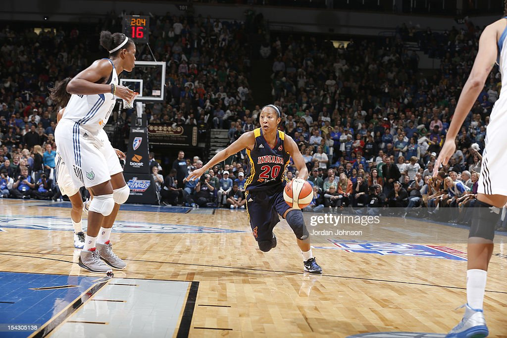 Briann January #20 of the Indiana Fever dribble the ball against Taj McWilliams-Franklin #8 of the Minnesota Lynx during the 2012 WNBA Finals Game Two on October 17, 2012 at Target Center in Minneapolis, Minnesota.