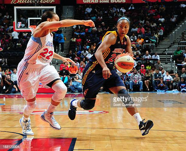 Briann January of the Indiana Fever drives against Armintie Price of the Atlanta Dream during Game 2 of the Eastern Conference SemiFinals at Philips...