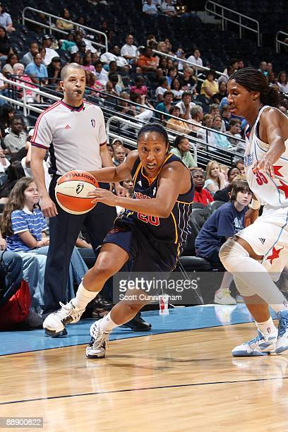 Briann January of the Indiana Fever drives to the basket against Angel McCoughtry of the Atlanta Dream during the game at Philips Arena on June 6...