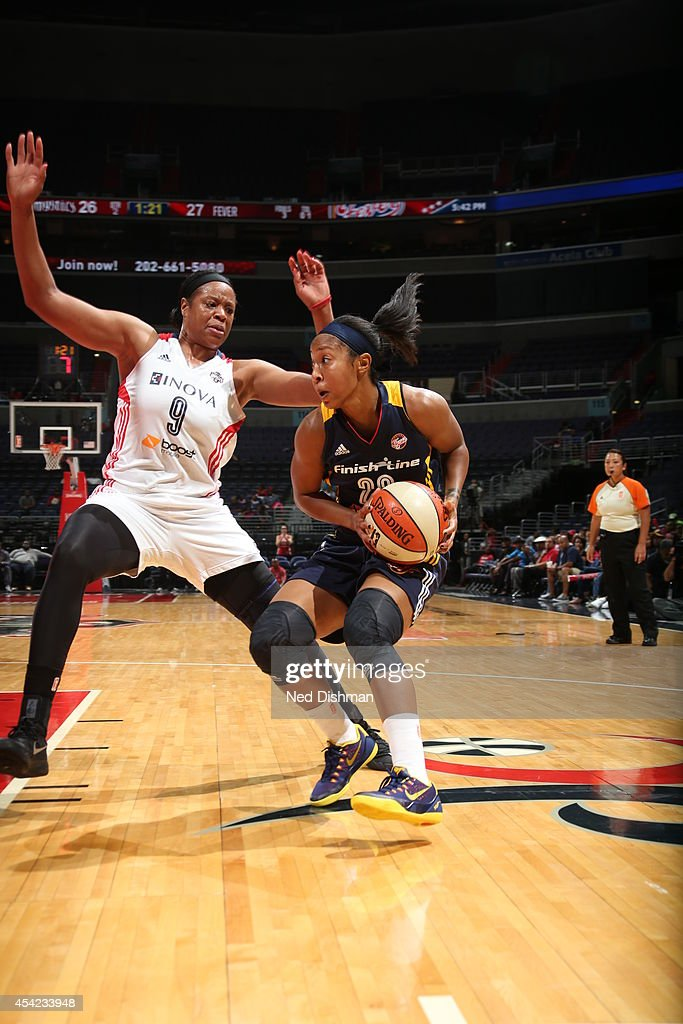 Briann January #20 of the Indiana Fever handles the ball against Kia Vaughn #9 of the Washington Mystics in Game Two of the Eastern Conference Semifinals during the 2014 WNBA Playoffs on August 23, 2014 at the Verizon Center in Washington, DC.