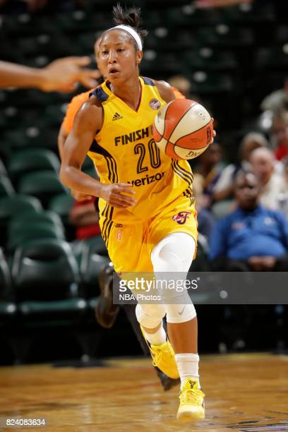 Briann January of the Indiana Fever handles the ball against the New York Liberty on July 28 2017 at Bankers Life Fieldhouse in Indianapolis Indiana...