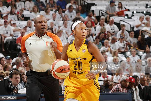 Briann January of the Indiana Fever handles the ball against the Dallas Wings on September 18 2016 at Bankers Life Fieldhouse in Indianapolis Indiana...