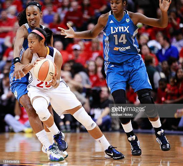 Briann January of the Indiana Fever looks to pass off the ball as Candice Wiggins of the Minnesota Lynx defends during Game Three of the 2012 WNBA...
