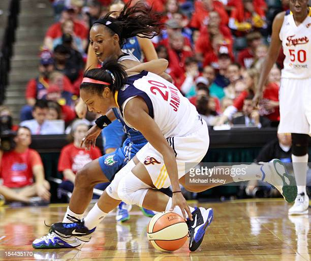Briann January of the Indiana Fever loses the handle on the ball as Candice Wiggins of the Minnesota Lynx defends during Game Three of the 2012 WNBA...