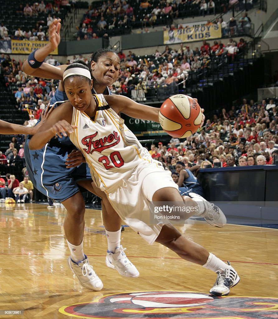Briann January #20 of the Indiana Fever takes to the hoop against Alana Beard #20 of the Washington Wizards during Game Two of the Eastern Conference Semifinals at Conseco Fieldhouse on September 19, 2009 in Indianapolis, Indiana.