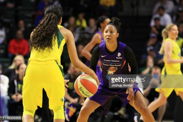 Briann January of the Phoenix Mercury defends Jordin Canada of the Seattle Storm on May 25 2019 at the Angel of the Winds Arena in Everett Washington...