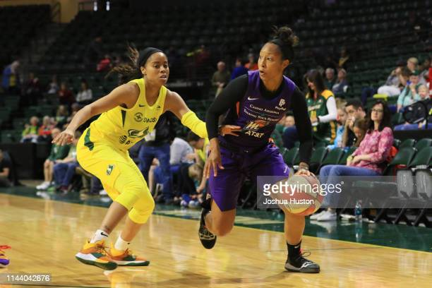 Briann January of the Phoenix Mercury handles the ball against the Seattle Storm on May 15 2019 at the Angel of the Winds Arena in Everett Washington...
