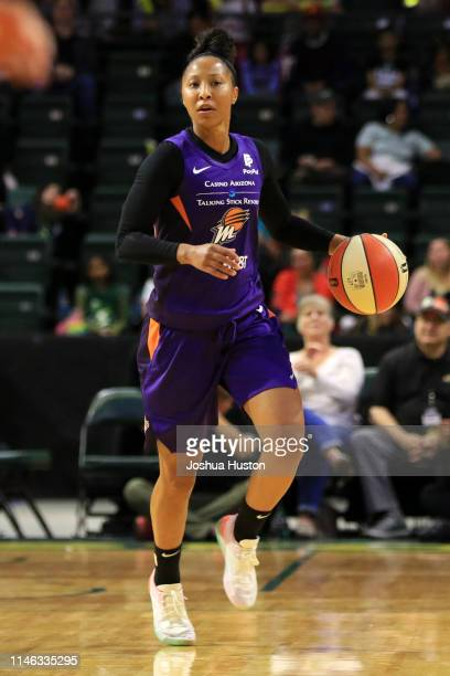 Briann January of the Phoenix Mercury handles the ball against the Seattle Storm on May 25 2019 at the Angel of the Winds Arena in Everett Washington...