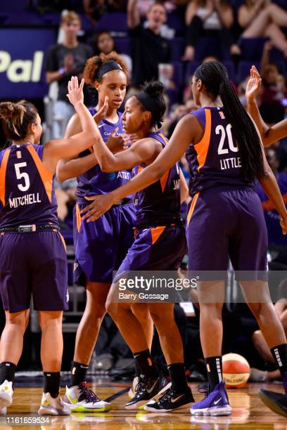 Briann January of the Phoenix Mercury high fives her teammates during the game against the Connecticut Sun on August 14 2019 at Talking Stick Resort...
