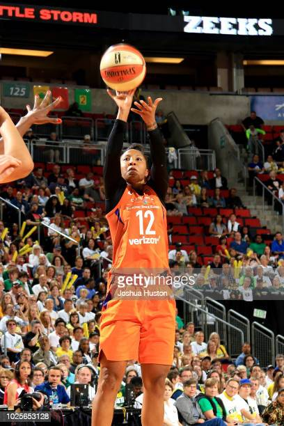 Briann January of the Phoenix Mercury shoots the ball against the Seattle Storm during Game Two of the WNBA SemiFinals at KeyArena in Seattle...