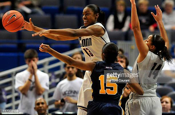 Brianna Banks and Bria Hartley of Connecticut pressure Carol Johnson of Pace during the second half in an 8535 UConn victory on Wednesday November 9...