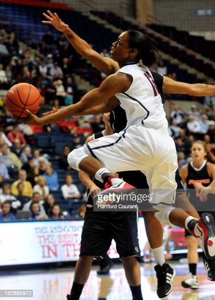 Brianna Banks of Connecticut drives into the lane against Pacific at Gampel Pavilion in Storrs Connecticut on Tuesday November 15 2011 UConn posted a...