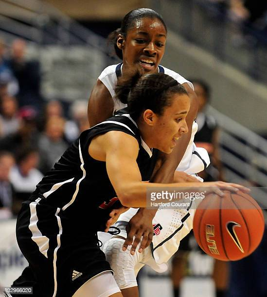 Brianna Banks of Connecticut tries to steal the ball from Kristina Johnson Pacific at Gampel Pavilion in Storrs Connecticut on Tuesday November 15...