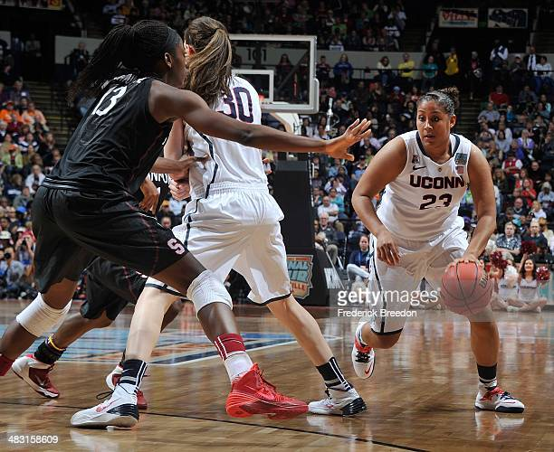 Brianna Banks of the Connecticut Huskies drives against Chiney Ogqumike of the Stanford Cardinal at Bridgestone Arena on April 6 2014 in Nashville...