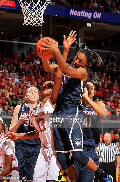 Brianna Banks of the Connecticut Huskies grabs a rebound against Alicia DeVaughn of the Maryland Terrapins at the Comcast Center on November 15 2013...