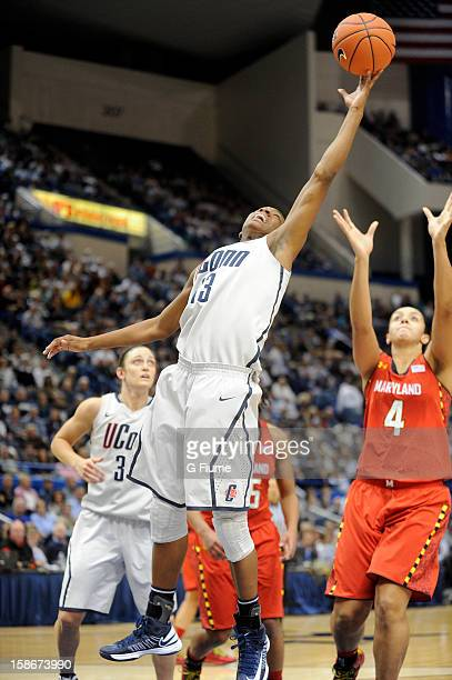 Brianna Banks of the Connecticut Huskies grabs a rebound against the Maryland Terrapins at the XL Center on December 3 2012 in Hartford Connecticut