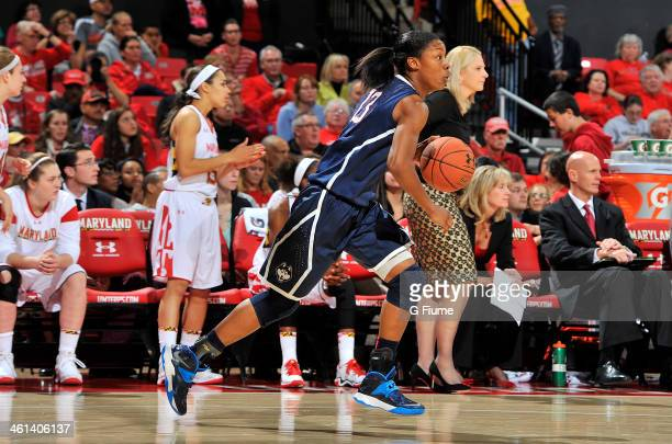 Brianna Banks of the Connecticut Huskies handles the ball against the Maryland Terrapins at the Comcast Center on November 15 2013 in College Park...