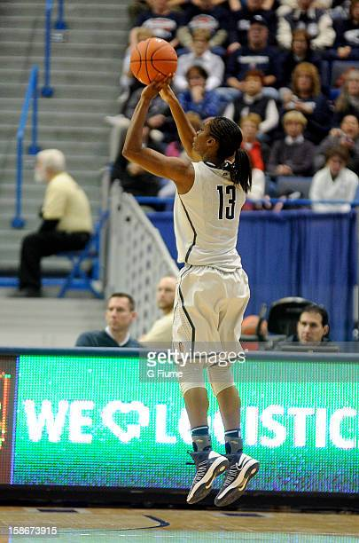 Brianna Banks of the Connecticut Huskies shoots the ball against the Maryland Terrapins at the XL Center on December 3 2012 in Hartford Connecticut