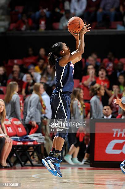 Brianna Banks of the Connecticut Huskies shoots the ball against the Maryland Terrapins at the Comcast Center on November 15 2013 in College Park...